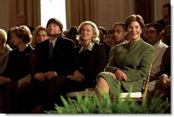 Hosting the Mark Twain Symposium, Laura Bush sits with documentary filmmaker Ken Burns in the East Room Nov. 29, 2001.   White House photo by Susan Sterner