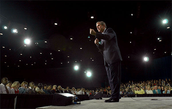 Meeting with about 4,000 displaced workers, President George W. Bush holds a town hall meeting at the Orange County Convention Center in Orlando, Fla., Tuesday, Dec. 4, 2001. White House photo by Eric Draper.