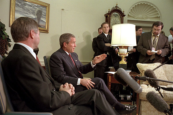 "Addressing the media, President George W. Bush meets with Norwegian Prime Minister Kjell Magne Bondevik in the Oval Office of the White House, December 5, 2001. ""We won't forget what took place,"" said President Bush, referring to the Sept. 11 terrorist attacks. ""And we will bring them to justice."" White House photo by Paul Morse."