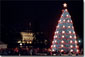 Leading the 2001 Christmas Pageant of Peace program, President George W. Bush and Mrs. Laura Bush preside over the lighting ceremonies for the National Christmas Tree, a 40-foot Colorado blue spruce. White House photo by Susan Sterner.