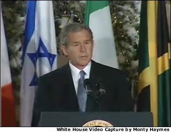 President George W. Bush led a worldwide initiative with the playing of the national anthem on December 11 at a White House event in the East Room at 8:46 a.m. (EST). The event marked the first ever live web cast on the White House web site. White House Video Capture by Monty Haymes.