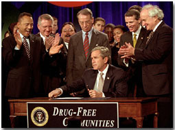President George W. Bush signs the Drug-Free Communities Act to help individual communities fight drug abuse Dec. 14.