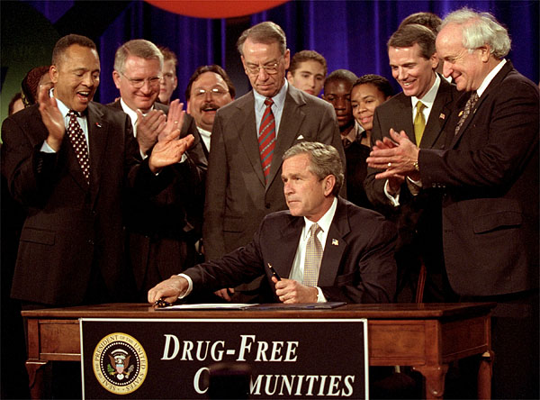 "President George W. Bush signs the Drug-Free Communities Act to help individual communities fight drug abuse Dec. 14. ""You're a part of America's armies of compassion, examples of service and citizenship,"" said the President in his remarks at a meeting of the Community Antidrug Coalitions of America. ""You restore hope to lives, and safety to neighborhoods."" White House photo by Eric Draper."