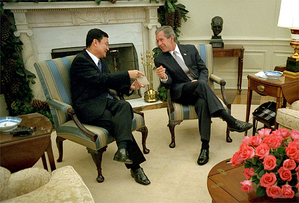 President George W. Bush meets with Prime Minister Thaksin Shinawatra of Thailand in the Oval Office Dec. 14, 2001. The two leaders discusses economic issues and the war on terrorism. White House photo by Eric Draper.