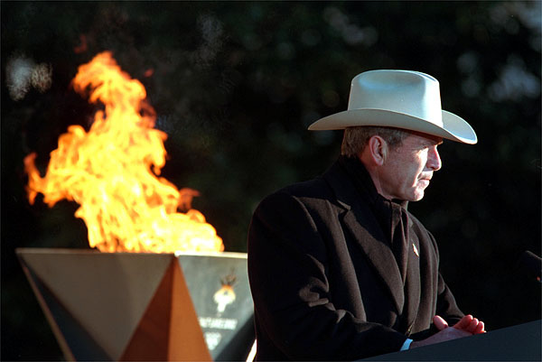 "President George W. Bush speaks during the 2002 Olympic Torch Relay Ceremony on the South Lawn Dec. 22. ""Each torch bearer's story is a lesson in citizenship and courage and compassion,"" said the President announcing the two torch runners, Liz Howell and Eric Jones. Both runners were profoundly affected by the Sept. 11 attacks. White House photo by Paul Morse."