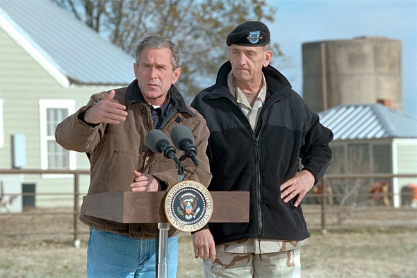President George W. Bush and Army General Tommy Franks talk with the press in Crawford, Texas, December 28. White House photo by Susan Sterner.