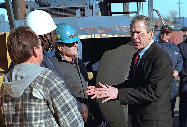 President George W. Bush talks with workers at the Port of New Orleans, Tuesday, Jan. 15, 2002. White House photo by Eric Draper.