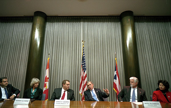 "President George W. Bush meets with labor leaders to discuss America's energy policy at the International Brotherhood of Teamsters headquarters in Washington, D.C., Jan. 17, 2001. From left to right, sitting with the President are Secretary of Energy Spencer Abraham, Secretary of the Interior Gale Norton, President of the Teamsters union James P. Hoffa, President of the United Brotherhood of Carpenters Doug McCarron and Secretary of Labor Elaine Chao. ""Together we can show the country that when we work together, we can do what's right, do what's right for the working folks,"" said the President in his remarks. White House photo by Eric Draper."