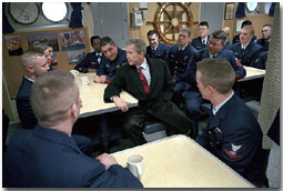 Sitting in the small mess hall decorated with pictures from New York, President George W. Bush takes time to talk during his tour of the United States Coast Guard Cutter Tahoma in Portland, Maine, Jan. 25. White House photo by Eric Draper.