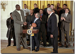 "President George W. Bush checks out the air up there as he welcomes Shaquille O'Neal and the rest of NBA Champion Los Angeles Lakers in the East Room Jan. 28. ""Being champs on the court means you've got to be champs off the court, as well,"" said the President. ""And I know these players understand that every time they do something, some kid is watching. Every time they say something, some kid is listening. And I want to thank the players who understand that with victory comes huge responsibility, to encourage people to make the right choices in life."" White House photo by Tina Hager."