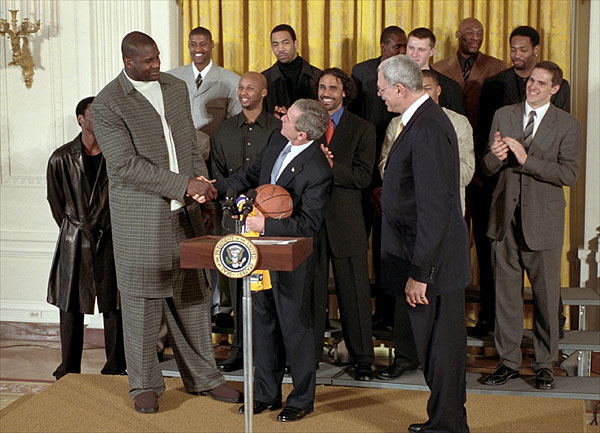 "President George W. Bush checks out the air up there as he welcomes Shaquille O'Neal and the rest of NBA Champion Los Angeles Lakers in the East Room Jan. 28. ""Being champs on the court means you've got to be champs off the court, as well,"" said the President. ""And I know these players understand that every time they do something, some kid is watching. Every time they say something, some kid is listening. And I want to thank the players who understand that with victory comes huge responsibility, to encourage people to make the right choices in life."" White House photo."