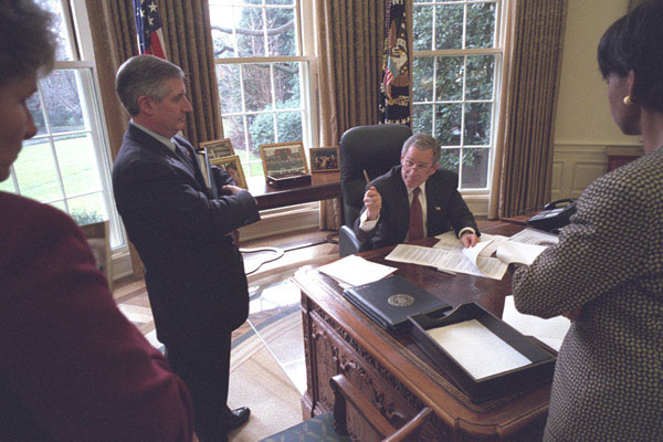 President Bush directs discussions of the State of the Union speech with senior White House staff members Andy Card, Karen Hughes and Dr. Condoleezza Rice in the Oval Office Thursday, January 24. White House photo by Eric Draper.
