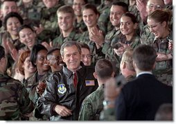 President George W. Bush is greeted with a thunderous cheer as he talks with troops during his visit to Elgin Air Force Base in Florida February 4.  White House photo by Paul Morse