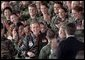 President George W. Bush is greeted with a thunderous cheer as he talks with troops during his visit to Elgin Air Force Base in Florida February 4. White House photo by Paul Morse.