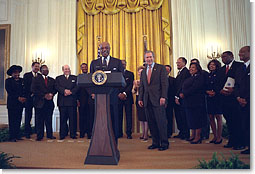 President George W. Bush listens as Secretary of Education Rod Paige speaks to visiting leaders from historically black colleges in the East Room, Feb. 12, 2002. Pledging to help historically black colleges, President Bush has created a presidential advisory board that will report on the schools' academic performances, uses of technology, and development. White House photo by Eric Draper.