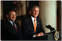 "President Bush and Pakistani President Pervez Musharraf address the media in Cross Hall, Feb. 13. ""The forces of history have accelerated the growth of friendship between the United States and Pakistan,"" said President Bush. Click here to view webcast. White House photo by Susan Sterner."