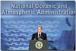 "President George W. Bush speaks during a visit to the National Oceanic and Atmospheric Administration Feb. 14. ""America and the world share this common goal: we must foster economic growth in ways that protect our environment,"" said the President as he announced new initiatives to foster economic growth while protecting the environment. White House photo by Paul Morse."