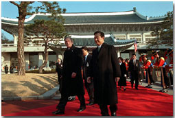 President George W. Bush and President Kim Dae-Jung proceed through an arrival ceremony at The Blue House in Seoul, Republic of Korea, Feb. 20.