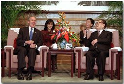 President George W. Bush and Chinese President Jiang Zemin talk during an arrival ceremony at The Great Hall of the People in Beijing, People's Republic of China, Feb. 21. White House photo by Paul Morse.