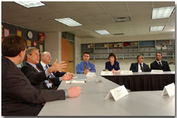 Before addressing the assembled audience and media, President George W. Bush holds a roundtable discussion with educators and students at Eden Prairie High School March 4. Pictured from left to right are Jeff Ireland, Principal of Eden Prairie; Mark Yudof, President of the University of Minnesota; Jesse Tejeda, student at the U of Minn.; Cathy Bockenstedt, science teacher at Central Middle School; Steve Cwodzinski, teacher at Eden Prairie; and Jesse Josephson, teacher at Forest Hills Elementary School. White House photo by Eric Draper.