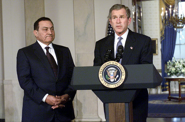 President George W. Bush and Egyptian President Mohammed Hosni Mubarek address the media in Cross Hall at the White House March 5. White House photo by Tina Hager.