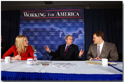 President George W. Bush participates in a roundtable discussion on corporate responsibility at America II Electronics in St. Petersburg, Florida, Friday, March 8, 2002. Also pictured at right, CEO of America II Electronics Michael Galinski, and employee Sarah Wood. White House photo by Eric Draper.