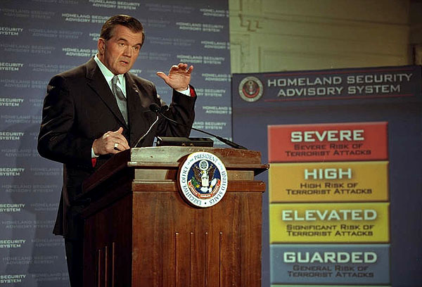 "Director of Homeland Security Tom Ridge presents the Homeland Security Advisory System to the media at Constitution Hall in Washington, D.C, March 12. ""The advisory system is based on five threat conditions or five different alerts: low, guarded, elevated, high and severe,"" said Director Ridge. "".it empowers government and citizens to take actions to address the threat."" White House photo by Paul Morse."