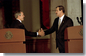 "President George W. Bush reaches for Mexico's President Vicente Fox during a joint press conference at the Palacio de Gobierno in Monterey, Mexico, Friday, March 22. ""The relationship between the United States and Mexico is very strong, is very important, and it's growing stronger every day,"" said President Bush in his remarks. White House photo by Eric Draper."