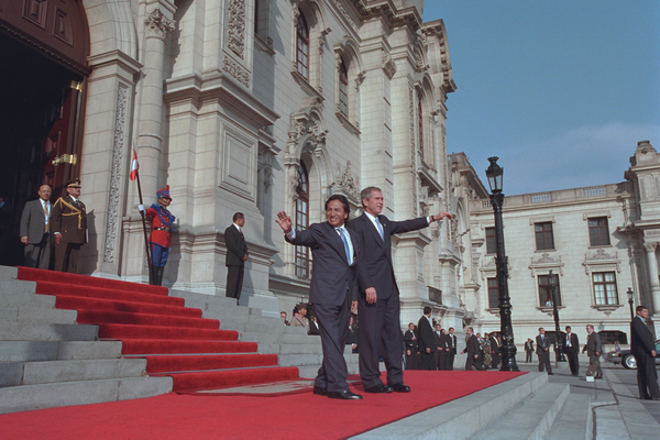 "President George W. Bush and Peruvian president Alejandro Toledo (right) wave from the steps of the Presidential Palace in Lima, Peru, March 23, 2002. ""It is an honor for me to be the first sitting President of the United States to visit Peru,"" said President Bush during the two leaders' joint press conference where he explained that steps such as reintroducing the Peace Corps to Peru are being taken to strengthen the relationship between America and Peru."