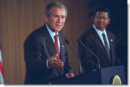 "President George W. Bush and El Salvador's President Francisco Flores (right) hold a joint press conference in San Salvador, El Salvador, March 24, 2002. ""El Salvador is one of the really great stories of economic and political transformation of our time. Just over a decade ago, this country was in civil war,"" said the President in his remarks. ""The country has renewed its commitment to democracy and economic reform and trade. It is one of the freest and strongest and most stable countries in our hemisphere."" White House photo by Eric Draper."