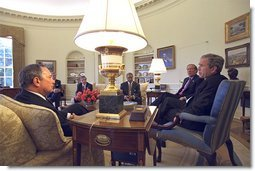 President George W. Bush meets with New York Governor George Pataki, right, and Mayor Michael Bloomberg in the Oval Office Monday, April 1. White House photo by Tina Hager.