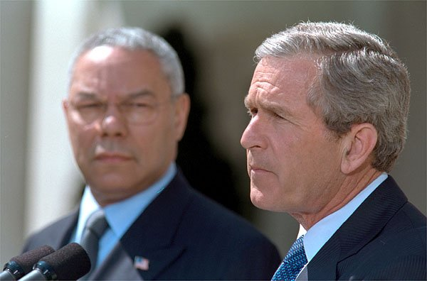 President George W. Bush outlines his plan to resolve the conflict in the Middle East as Secretary of State Colin Powell stands by his side in the Rose Garden Thursday, April 4. White House photo by Paul Morse.