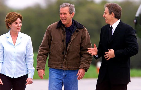President George W. Bush and Laura Bush share a little bit of Texas hospitality with Prime Minister Tony Blair as the British leader arrives for a weekend retreat at Priarie Chapel Ranch Friday, April 5. White House photo by Paul Morse.