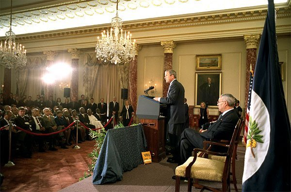 "President George W. Bush discusses the Trade Promotion Authority in the Benjamin Franklin Room at the Department of State Thursday, April 4. ""I believe strongly in trade. I believe not only is trade in my nation's interests, I think trade is in the interest of those nations who struggle with poverty, that desire a route out of poverty,"" said the President. White House photo by Paul Morse."