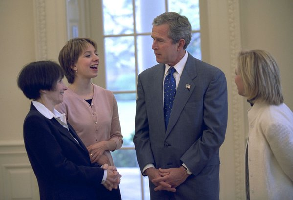 President George W. Bush meets with Sarah Hughes, Olympic gold medalist and figure skater (center, left), her mother, Amy Hughes (far left), and her coach Robin Wagner in the Oval Office Friday, April 12, 2002. White House photo by Eric Draper.