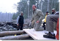 "President George W. Bush takes a working tour of The Adirondack Park near Wilmington, NY, Monday, April 22. ""We had a great time in the Park, and I want to thank you all very much for giving me the opportunity to hammer and stack, place gravel -- (laughter) -- in a beautiful part of the world. This is quite a sight for a fellow from Texas,"" said the President in his remarks about Earth Day at Whiteface Mountain Lodge. ""We have a duty in our country to make sure our land is preserved, our air is clean, our water is pure, our parks are accessible and open and well- preserved.""  White House photo by Eric Draper"