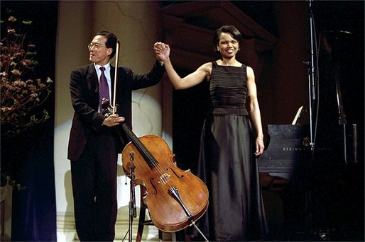 Cellist Yo-Yo Ma and National Security Advisor Dr. Condoleezza Rice take their bow after performing a duet to a Brahm's sonata at the presentation of awards by the National Endowment of the Arts and Humanities at Constitution Hall in Washington, DC , April 22. White House photo by Paul Morse.