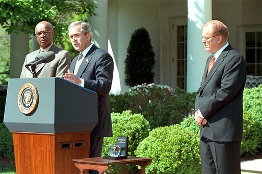 President George W. Bush and Secretary of Education Rod Paige present the 2002 Teacher of the Year award to Chauncey Veatch, right, in the Rose Garden at the White House Wednesday, April 24. Mr. Veatch is a social studies teacher at Coachella Valley High School in Thermal, Calif., White House photo by Paul Morse.