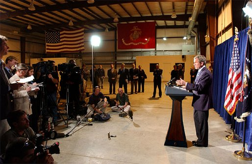 President George W. Bush delivers remarks to the press inside the Marine One hangar at the Bush Ranch in Crawford, Texas following his meeting with the Crown Prince of Saudi Arabia, Thursday, April 25, 2002. White House photo by Tina Hager.
