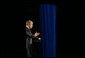 Photographed through stage curtains, President George W. Bush delivers his remarks on compassionate Conservatism at Parkside Hall in San Jose, Ca., Tuesday, April 30.  White House photo by Eric Draper.
