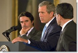 President George W. Bush speaks as European Union President and Spanish Prime Minister Jose Maria Aznar (left) and the European Commission President Romano Prodi listen during a new conference in the East Room of the White House, Thursday, May 2, 2002. White House photo by Paul Morse.