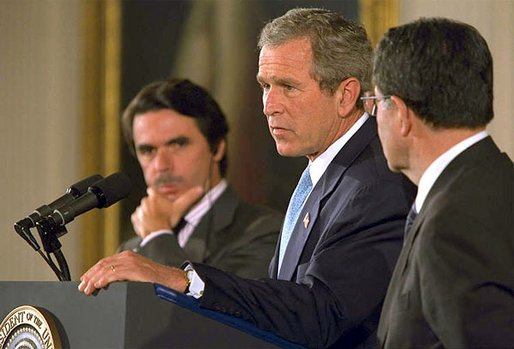 President George W. Bush speaks as European Union President and Spanish Prime Minister Jose Maria Aznar (left) and the European Commission President Romano Prodi listen during a press briefing in the East Room of the White House, Thursday, May 2, 2002. White House photo by Paul Morse.