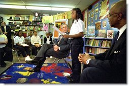 President George W. Bush listens to students read about American values during a visit to Vandenberg Elementary School in Southfield, Mich., Monday, May 6. White House photo by Tina Hager.