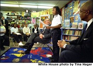 President George W. Bush listens to students read about American values during a visit to Vandenberg Elementary School in Southfield, Mich., Monday, May 6.