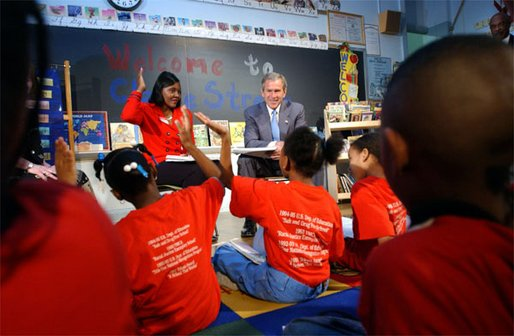 "President George W. Bush visits with teacher Carolyn Davis and her students at Clarke Street Elementary School in Milwaukee, Wis., Wednesday, May 8. ""I'm here because this is a great school that believes every child can learn,"" said President Bush who listened to the students demonstrate their reading drills. During his talk with the children, the President emphasized the importance of reading over watching television."