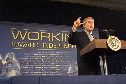 "President George W. Bush discusses welfare reforms during a visit to St. Stephens Community House in Columbus, Ohio, May 10, 2002. ""(St. Stephens) is a living example of what we call a one-stop center, where people who need help are able to come and find help to help themselves."" White House photo by Paul Morse."
