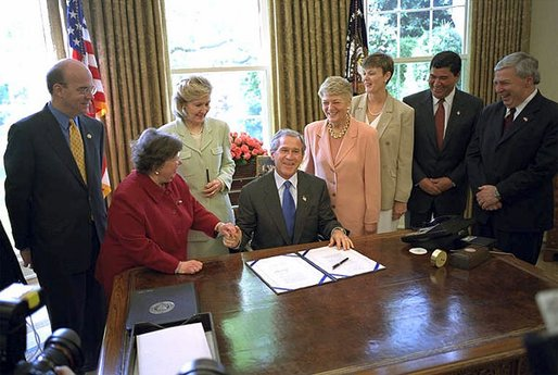 President George W. Bush signs the Hematological Cancer Research Investment and Education Act in the Oval Office May 14. White House photo by Eric Draper.