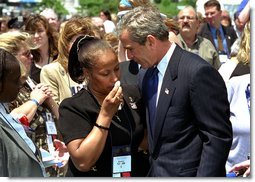 "President George W. Bush embraces a woman at the 21st Annual Peace Officers Association Memorial Service at the United States Capitol Wednesday, May 15. ""When an officer dies in the line of duty, an entire community will pause in sorrow and in admiration with the depth of feeling Americans reserve for people who protect us every day,"" said the President in his remarks to the families of fallen peace officers. White House photo by Tina Hager."