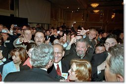 President George W. Bush wades into an enthusiastic crowd after speaking at the Hispanic National Prayer Breakfast in Washington, D.C., May 16, 2002. White House photo by Paul Morse.