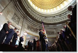 "Rev. Daniel P. Coughlin leads the President and guests in prayer at the beginning of the Gold Medal ceremony. ""President Reagan believed deeply in American character and destiny,"" said President Bush. ""He believed deeply in the power of freedom to improve the lives of average men and women. These ideas changed America, and they changed the world. Not only because he eloquently explained them, because they are right and they are true."" White House photo by Tina Hager."